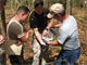 A biologist in the Charleston District regulatory division shows cadets from The Citadel how to use a soil chart to determine wetlands.