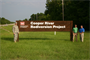 USACE personnel  stand at the entrance to the Cooper River Rediversion  Project which saves taxpayers approximately $14-18 million per year in dredging costs in Charleston Harbor